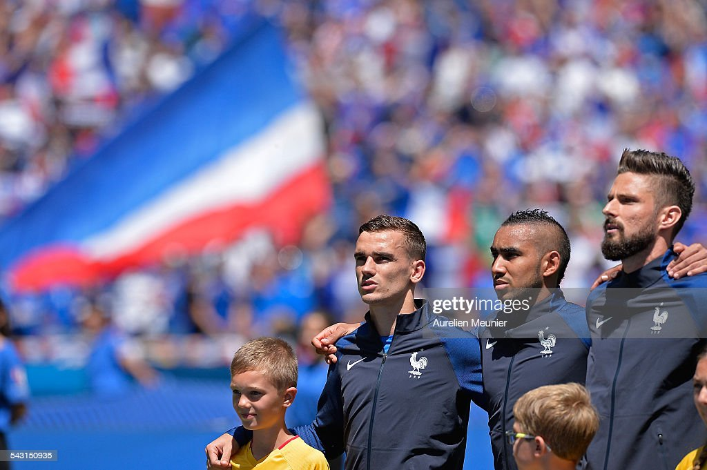 <a gi-track='captionPersonalityLinkClicked' href=/galleries/search?phrase=Antoine+Griezmann&family=editorial&specificpeople=7197539 ng-click='$event.stopPropagation()'>Antoine Griezmann</a>, <a gi-track='captionPersonalityLinkClicked' href=/galleries/search?phrase=Dimitri+Payet&family=editorial&specificpeople=2137146 ng-click='$event.stopPropagation()'>Dimitri Payet</a>, <a gi-track='captionPersonalityLinkClicked' href=/galleries/search?phrase=Olivier+Giroud&family=editorial&specificpeople=5678034 ng-click='$event.stopPropagation()'>Olivier Giroud</a> of France react during the national anthem before the UEFA Euro 2016 round of 16 match between France and the Republic of Ireland at Stade des Lumieres on June 26, 2016 in Lyon, France.