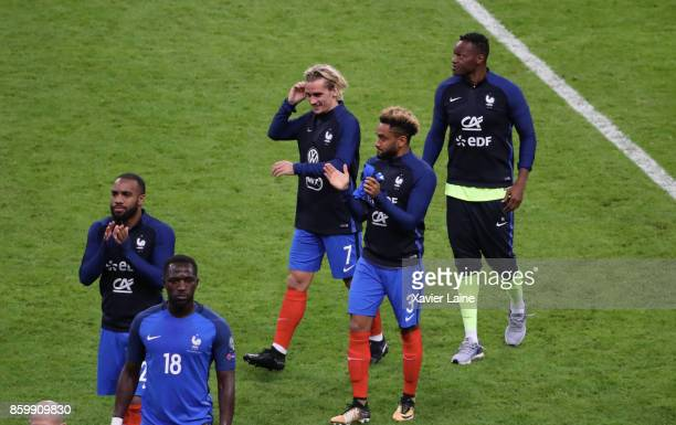 Antoine Griezmann Jordan Amavi and Steve Mandanda of France celebrate the qualification after the FIFA 2018 World Cup Qualifier between France and...