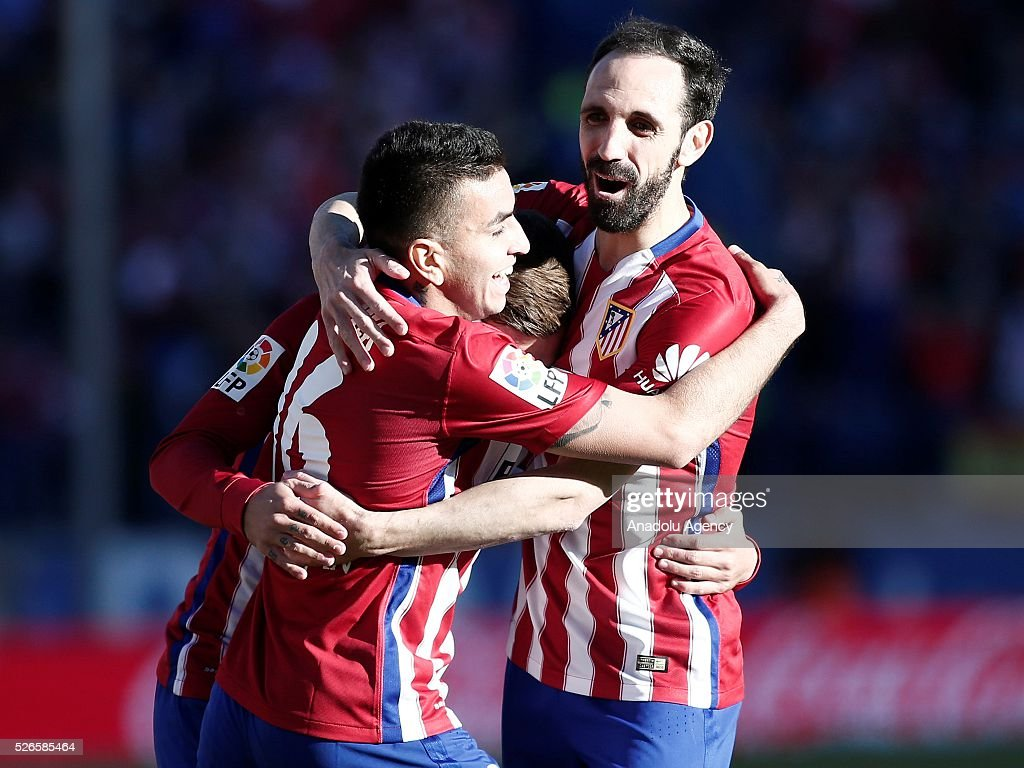 Antoine Griezmann (C), Juanfran (R) and Angel Correa (L) of Atletico Madrid celebrate their team's goal during the La Liga football match between Atletico Madrid and Rayo Vallecano at Vicente Calderon, in Madrid, Spain on April 30, 2016.