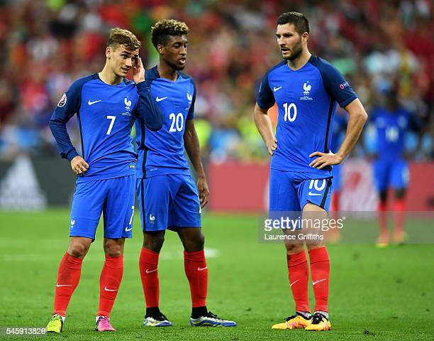 Antoine Griezmann Kingsley Coman and AndrePierre Gignac of France show their dejection after Portugal's first goal during the UEFA EURO 2016 Final...