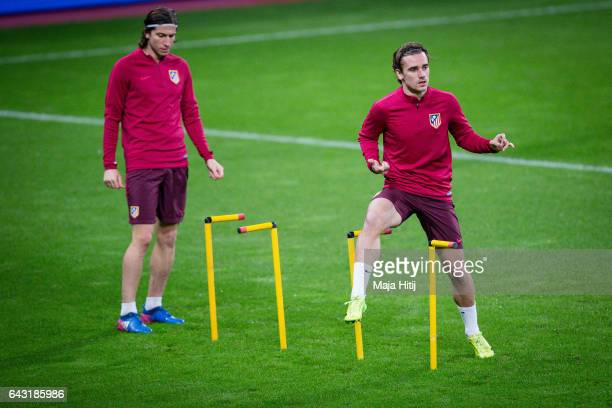 Antoine Griezmann of Atletico and Filipe Luis of Atletico warm up during the training prior the UEFA Champions League Round of 16 first leg match...