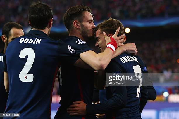 Antoine Griezmann of Atletico celebrates his team's first goal with team mates Saul Niguez and Diego Godin during the UEFA Champions league Quarter...