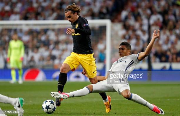 Antoine Griezmann of Atletico de Madrid and Casemiro Real Madrid battle for the ball during the UEFA Champions League semifinal first leg match...