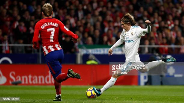 Antoine Griezmann of Atletico de Madrid and Luka Modric of Real Madrid battle for the ball during a match between Atletico Madrid and Real Madrid as...