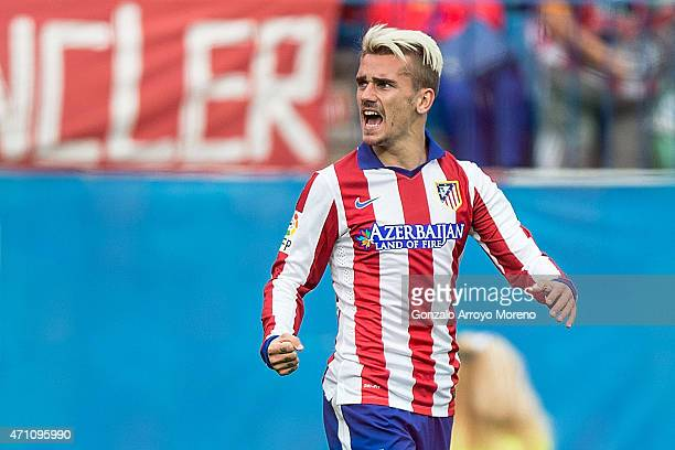 Antoine Griezmann of Atletico de Madrid celebrates scoring their opening goal during the La Liga match between Club Atletico de Madrid and Elche FC...