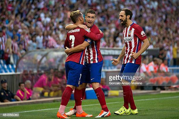 Antoine Griezmann of Atletico de Madrid celebrates scoring their opening goal with teammates Gabi Fernandez and Juan Francisco Torres alias Juanfran...