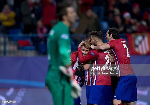 Antoine Griezmann of Atletico de Madrid celebrates scoring their second goal with teammates behind goalkeeper Fernando Muslera of Galatasaray AS...