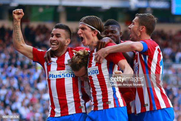 Antoine Griezmann of Atletico de Madrid celebrates scoring their opening goal with teammates Angel Martin Correa Filipe Luis Thomas Teye Partey and...