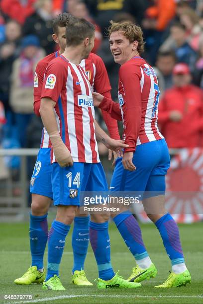 Antoine Griezmann of Atletico de Madrid celebrates with teammates after scoring the third goal of his team during the La Liga match between Atletico...