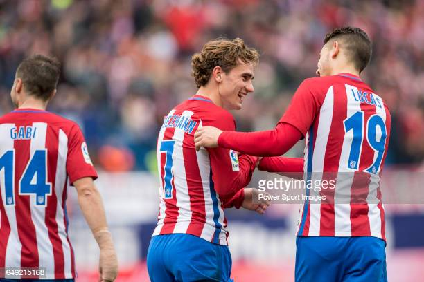 Antoine Griezmann of Atletico de Madrid celebrates with teammates Lucas Hernandez and Gabriel Fernandez Arenas Gabi during the match Atletico de...
