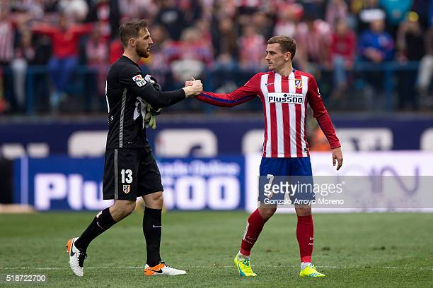 Antoine Griezmann of Atletico de Madrid clashes hands with goalkeeper Jan Oblak after the La Liga match between Club Atletico de Madrid and Real...