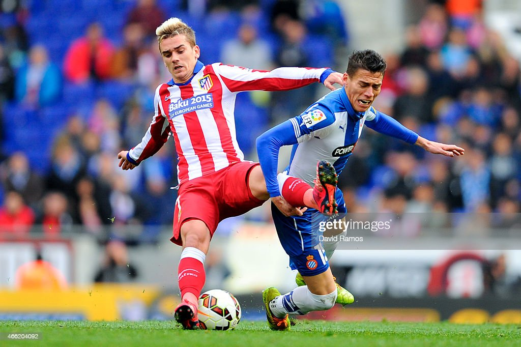 Antoine Griezmann of Atletico de Madrid competes for the ball with Hector Moreno of RCD Espanyol during the La Liga match between RCD Espanyol and...