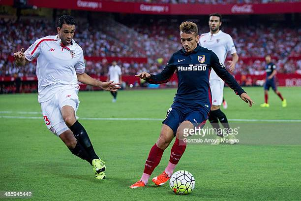 Antoine Griezmann of Atletico de Madrid competes for the ball with Adil Rami of Sevilla FC during the La Liga match between Sevilla FC and Club...