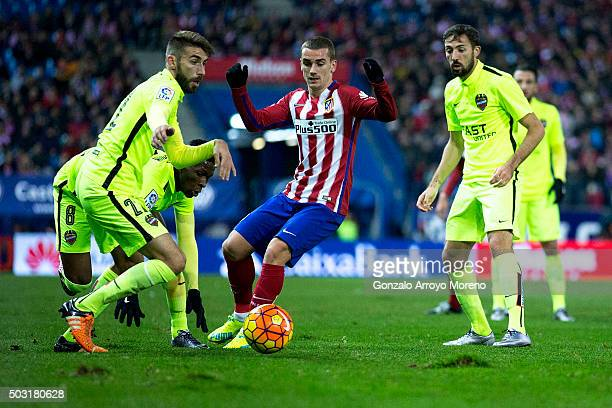 Antoine Griezmann of Atletico de Madrid competes for the ball with Jose Maria Bejarano of Levante UD during the La Liga match between Club Atletico...