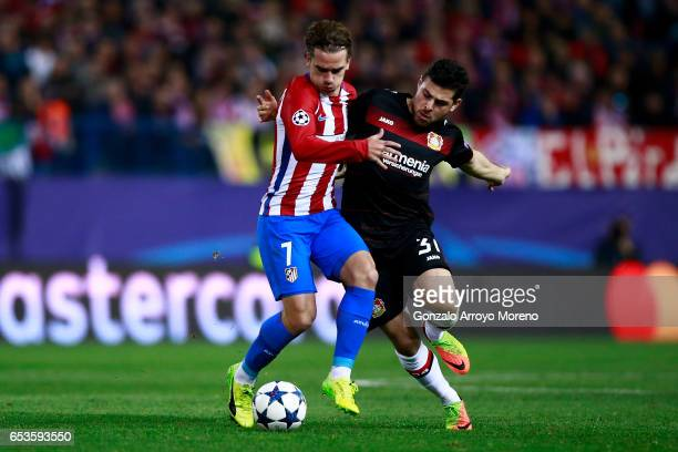 Antoine Griezmann of Atletico de Madrid competes for the ball with Kevin Volland of Bayer Leverkusen during the UEFA Champions League Round of 16...
