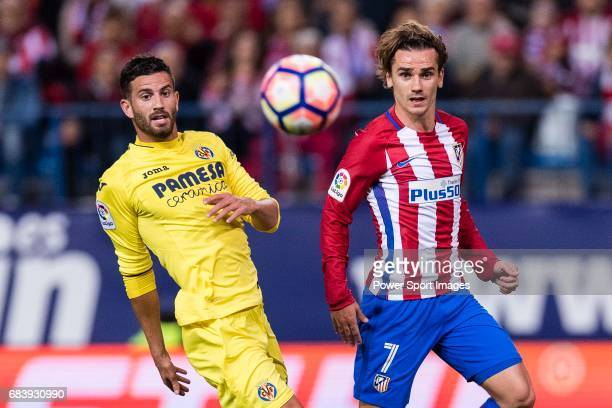 Antoine Griezmann of Atletico de Madrid fights for the ball with Mateo Pablo of Villarreal during the La Liga match between Atletico de Madrid vs...