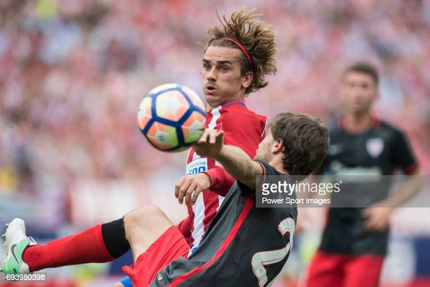Antoine Griezmann of Atletico de Madrid fights for the ball with Yeray Alvarez Lopez of Athletic Club during the La Liga match between Atletico de...