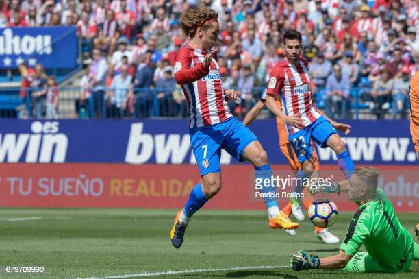 Antoine Griezmann of Atletico de Madrid fights the ball with Yoel Rodriguez of Eibar during a match between Club Atletico Madrid and SD Eibar as part...