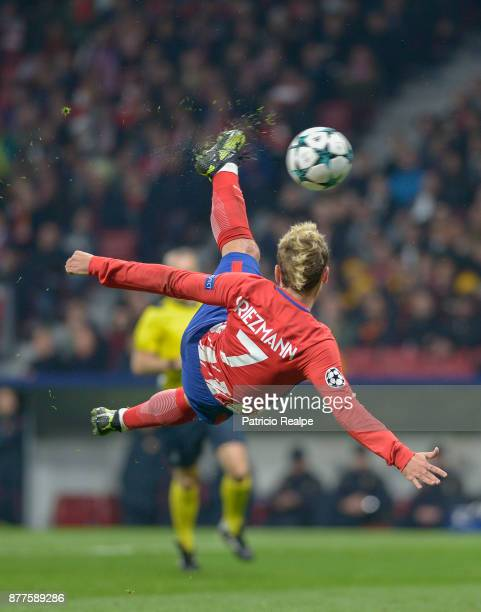 Antoine Griezmann of Atletico de Madrid hits the ball and scores the first goal of his team during a match between Atletico Madrid and AS Roma as...