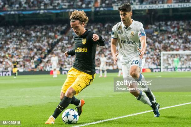Antoine Griezmann of Atletico de Madrid is followed by Marco Asensio Willemsen of Real Madrid during their 201617 UEFA Champions League Semifinals...