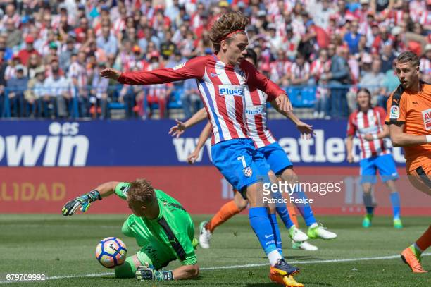Antoine Griezmann of Atletico de Madrid jumps past Yoel Rodriguez of Eibar during a match between Club Atletico Madrid and SD Eibar as part of La...