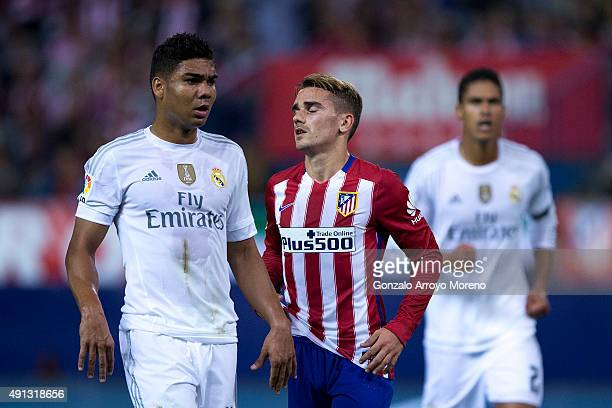 Antoine Griezmann of Atletico de Madrid reacts as he fail to score surrounded by Gabi Fernandez of Real Madrid CF and his teammate Raphael Varane...