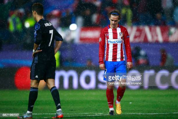 Antoine Griezmann of Atletico de Madrid reacts behind Cristiano Ronaldo during the UEFA Champions League Semi Final second leg match between Club...