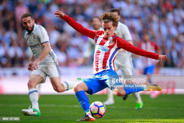 Antoine Griezmann of Atletico de Madrid scores their opening goal during the La Liga match between Real Madrid CF and Club Atletico de Madrid at...