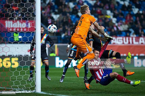 Antoine Griezmann of Atletico de Madrid scores their second goal against goalkeeper Yoel Rodriguez of Rayo Vallecano de Madrid during the Copa del...