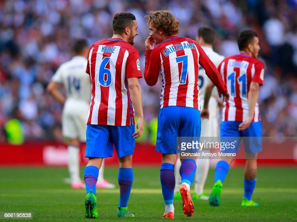 Antoine Griezmann of Atletico de Madrid speaks with his teammate Koke after scoring their opening goal during the La Liga match between Real Madrid...