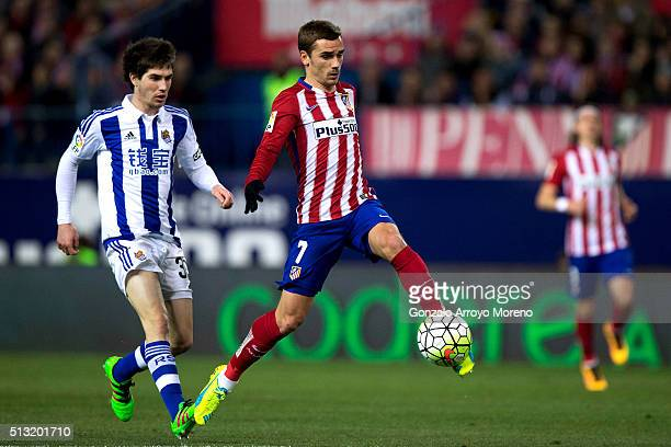 Antoine Griezmann of Atletico de Madrid strikes the ball ahead Gorka Elustondo during the La Liga match between Club Atletico de Madrid and Real...
