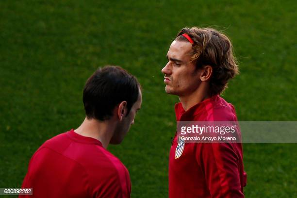 Antoine Griezmann of Atletico de Madrid walks behind his teammate Diego Godin during a training session ahead of the UEFA Champions League Semifinal...