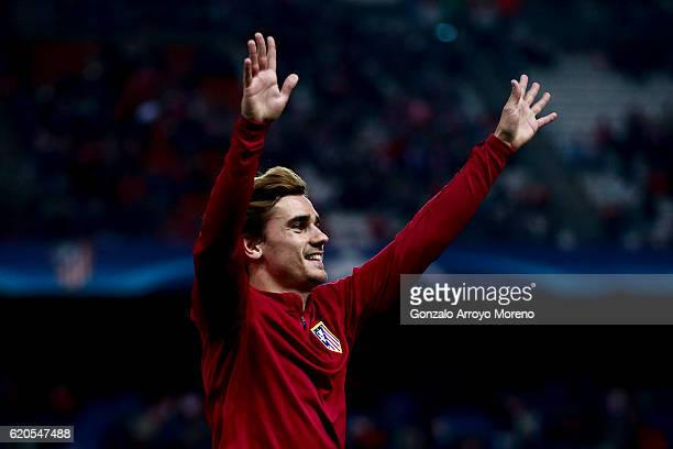 Antoine Griezmann of Atletico de Madrid waves the audience after his warming up before the UEFA Champions League Group D match between Club Atletico...