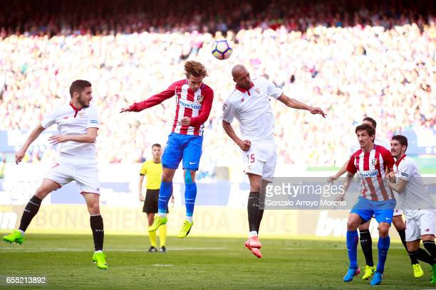 Antoine Griezmann of Atletico de Madrid wins the header before Steven N'Zonzi of Sevilla FC during the La Liga match between Club Atletico de Madrid...