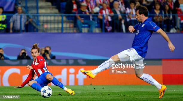 Antoine Griezmann of Atletico Madrid and Christian Fuchs of Leicester City battle for the ball during the UEFA Champions League Quarter Final first...