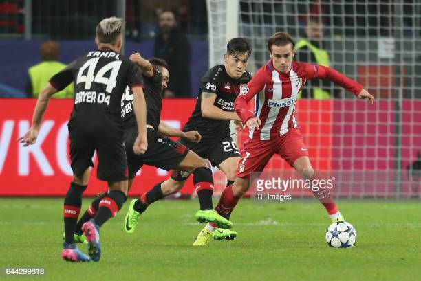 Antoine Griezmann of Atletico Madrid and Kevin Kampl Karim Bellarabi and Charles Aranguiz of Bayer Leverkusen battle for the ball during the UEFA...
