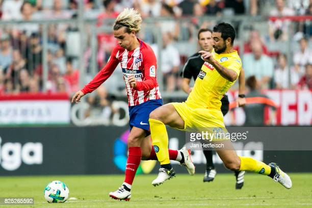 Antoine Griezmann of Atletico Madrid and Raul Albiol of SSC Napoli fight for the ball during the Audi Cup 2017 match between Club Atletico de Madrid...