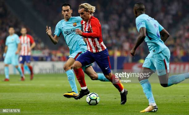 Antoine Griezmann of Atletico Madrid and Sergio Busquets battle for the ball during the La Liga match between Club Atletico Madrid and FC Barcelona...