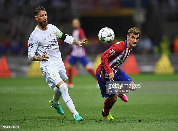 Antoine Griezmann of Atletico Madrid and Sergio Ramos of Real Madrid chase after the ball during the UEFA Champions League Final match between Real...