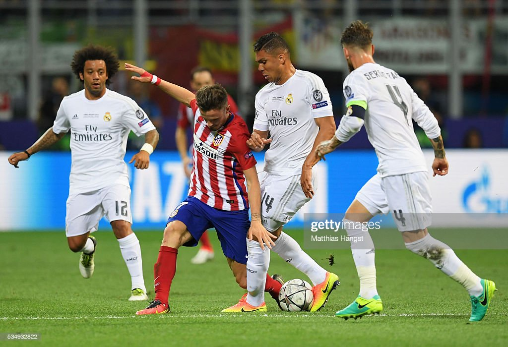 <a gi-track='captionPersonalityLinkClicked' href=/galleries/search?phrase=Antoine+Griezmann&family=editorial&specificpeople=7197539 ng-click='$event.stopPropagation()'>Antoine Griezmann</a> of Atletico Madrid battles for the ball with <a gi-track='captionPersonalityLinkClicked' href=/galleries/search?phrase=Casemiro&family=editorial&specificpeople=7150894 ng-click='$event.stopPropagation()'>Casemiro</a> of Real Madrid during the UEFA Champions League Final match between Real Madrid and Club Atletico de Madrid at Stadio Giuseppe Meazza on May 28, 2016 in Milan, Italy.