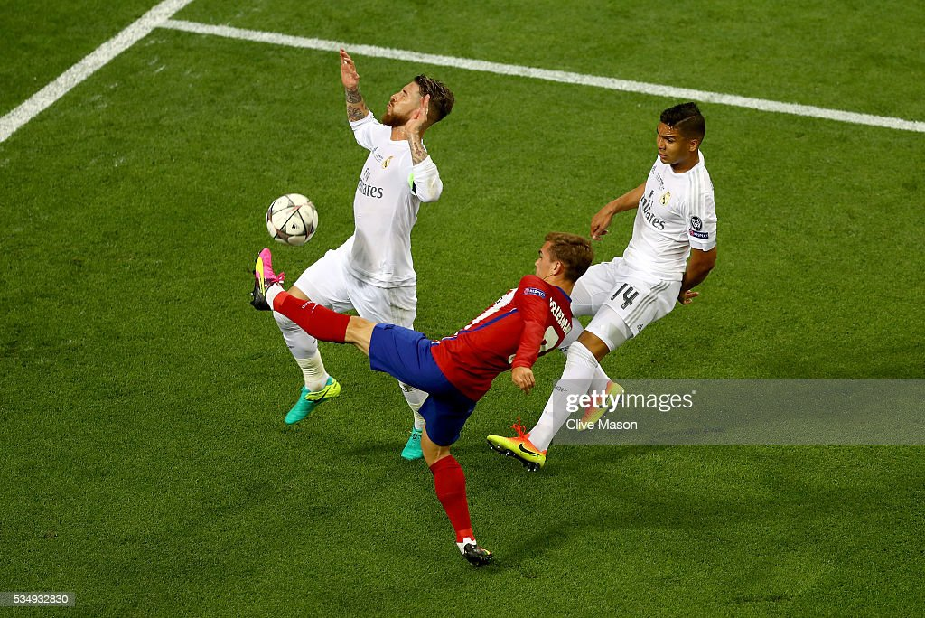 <a gi-track='captionPersonalityLinkClicked' href=/galleries/search?phrase=Antoine+Griezmann&family=editorial&specificpeople=7197539 ng-click='$event.stopPropagation()'>Antoine Griezmann</a> of Atletico Madrid battles for the ball with Sergio Ramos of Real Madrid during the UEFA Champions League Final match between Real Madrid and Club Atletico de Madrid at Stadio Giuseppe Meazza on May 28, 2016 in Milan, Italy.