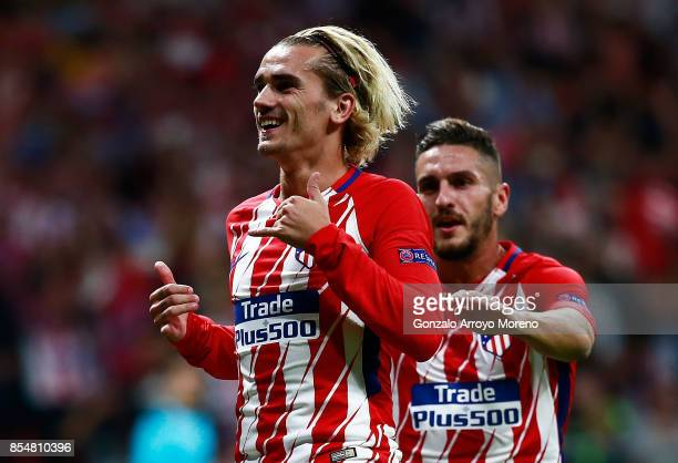 Antoine Griezmann of Atletico Madrid celebrates after he scores his sides first goal from the penalty spot during the UEFA Champions League group C...