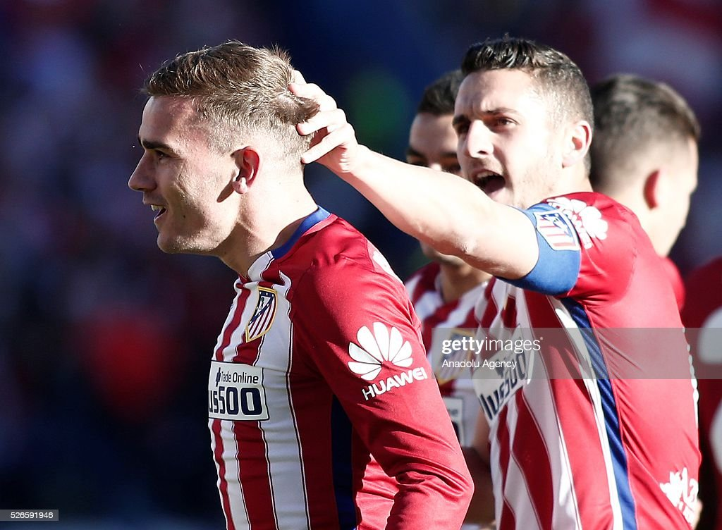 Antoine Griezmann (L) of Atletico Madrid celebrates after scoring a goal during the La Liga football match between Atletico Madrid and Rayo Vallecano at Vicente Calderon, in Madrid, Spain on April 30, 2016.