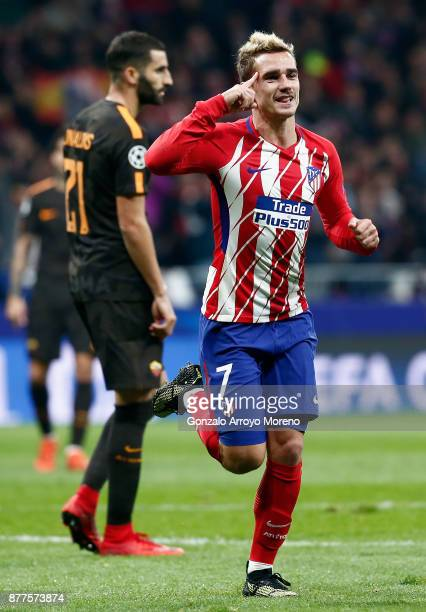 Antoine Griezmann of Atletico Madrid celebrates after scoring his team's opening goal during the UEFA Champions League group C match between Atletico...