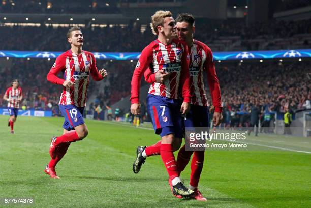 Antoine Griezmann of Atletico Madrid celebrates after scoring his team's opening goal with Jose Maria Gimenez of Atletico Madrid and Lucas Hernandez...