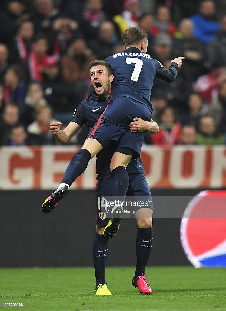 <a gi-track='captionPersonalityLinkClicked' href=/galleries/search?phrase=Antoine+Griezmann&family=editorial&specificpeople=7197539 ng-click='$event.stopPropagation()'>Antoine Griezmann</a> of Atletico Madrid (7) celebrates with <a gi-track='captionPersonalityLinkClicked' href=/galleries/search?phrase=Gabi+-+Soccer+Player&family=editorial&specificpeople=6912055 ng-click='$event.stopPropagation()'>Gabi</a> as he scores their first goal during UEFA Champions League semi final second leg match between FC Bayern Muenchen and Club Atletico de Madrid at Allianz Arena on May 3, 2016 in Munich, Germany.