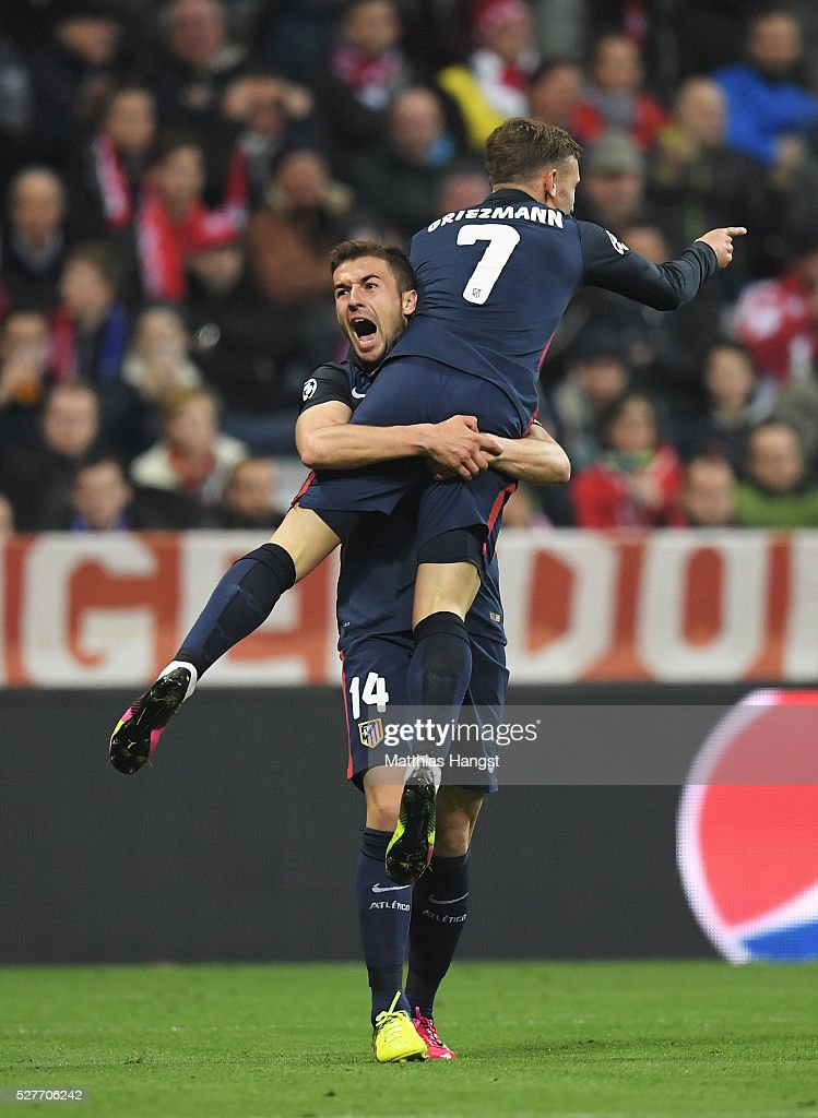 Antoine Griezmann of Atletico Madrid (7) celebrates with Gabi as he scores their first goal during UEFA Champions League semi final second leg match between FC Bayern Muenchen and Club Atletico de Madrid at Allianz Arena on May 3, 2016 in Munich, Germany.