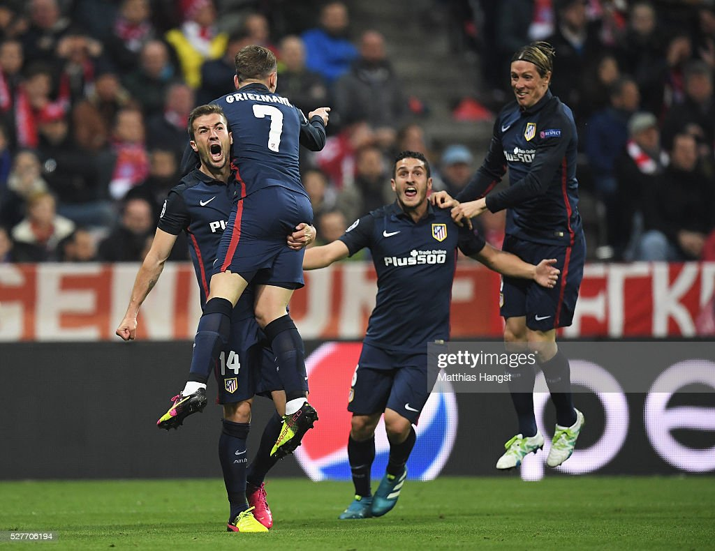 <a gi-track='captionPersonalityLinkClicked' href=/galleries/search?phrase=Antoine+Griezmann&family=editorial&specificpeople=7197539 ng-click='$event.stopPropagation()'>Antoine Griezmann</a> of Atletico Madrid (7) celebrates with <a gi-track='captionPersonalityLinkClicked' href=/galleries/search?phrase=Gabi+-+Fu%C3%9Fballspieler&family=editorial&specificpeople=6912055 ng-click='$event.stopPropagation()'>Gabi</a> (L), <a gi-track='captionPersonalityLinkClicked' href=/galleries/search?phrase=Koke+-+Mittelfeldspieler+geb.+1992&family=editorial&specificpeople=11132098 ng-click='$event.stopPropagation()'>Koke</a> (2R) and <a gi-track='captionPersonalityLinkClicked' href=/galleries/search?phrase=Fernando+Torres&family=editorial&specificpeople=194755 ng-click='$event.stopPropagation()'>Fernando Torres</a> (R) as he scores their first goal during UEFA Champions League semi final second leg match between FC Bayern Muenchen and Club Atletico de Madrid at Allianz Arena on May 3, 2016 in Munich, Germany.
