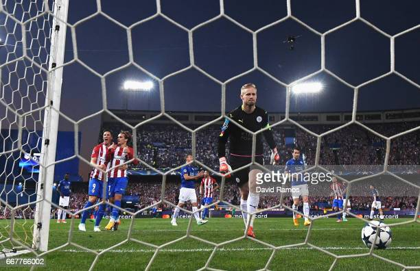 Antoine Griezmann of Atletico Madrid celebrates with team mate Fernando Torres after scoring the opening goal of the game as Kasper Schmeichel of...