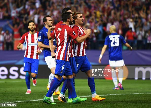 Antoine Griezmann of Atletico Madrid celebrates with team mates after scoring his team's first goal of the game from the penalty spot during the UEFA...